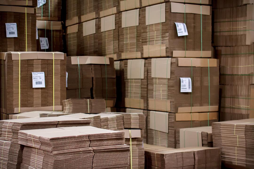 Corrugated bundles inside our paper and packaging warehouse near Cincinnati, OH